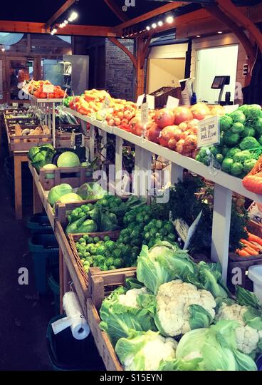 Fruit and veg stall with plenty of winter vegetables - Stock Image