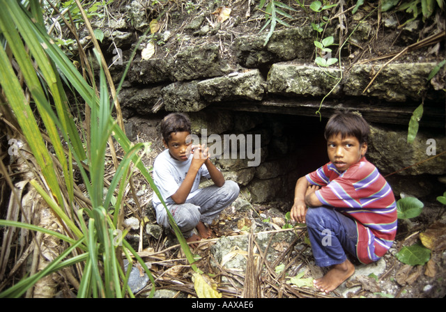 kids and WWII site in the remote islands of the Western Pacific - Stock Image