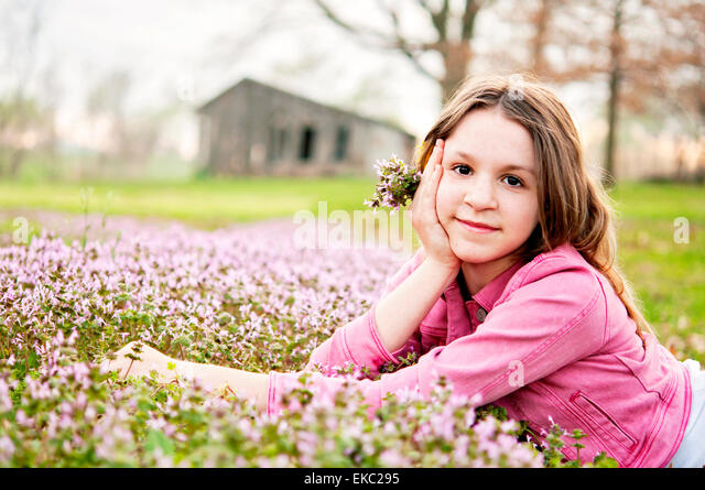 Girl Spring portrait flowers - Stock Image
