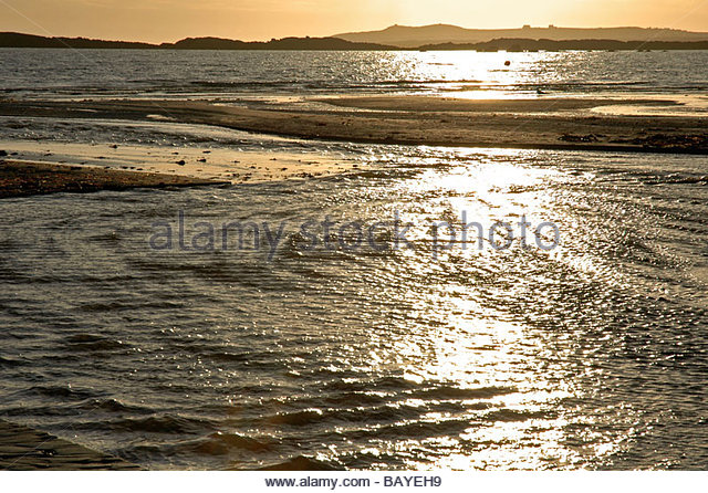 Evening sunset over sea at Rhosneigr Anglesey - Stock Image