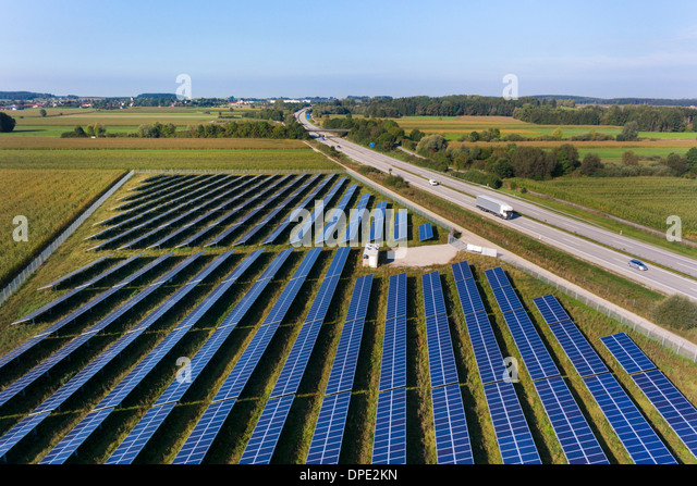 View of road and solar power panels, Munich, Bavaria, Germany - Stock Image