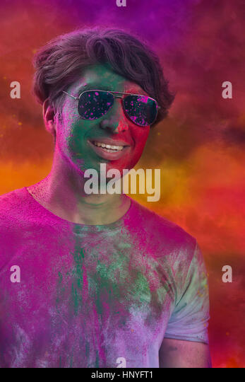 Portrait Of Young Man With Paint On Face During Holi - Stock-Bilder