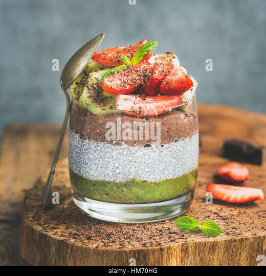 Healthy breakfast concept in glass over wooden board - Stock Image