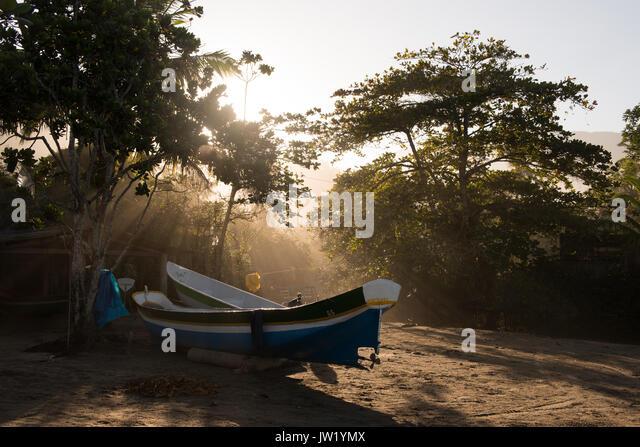 Fishing canoes in Castelhanos, Ilhabela, Brazil - Stock Image