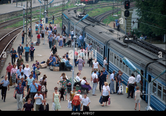 Russia Moscow Belarus Train Station passenger platform commuters travelers - Stock Image