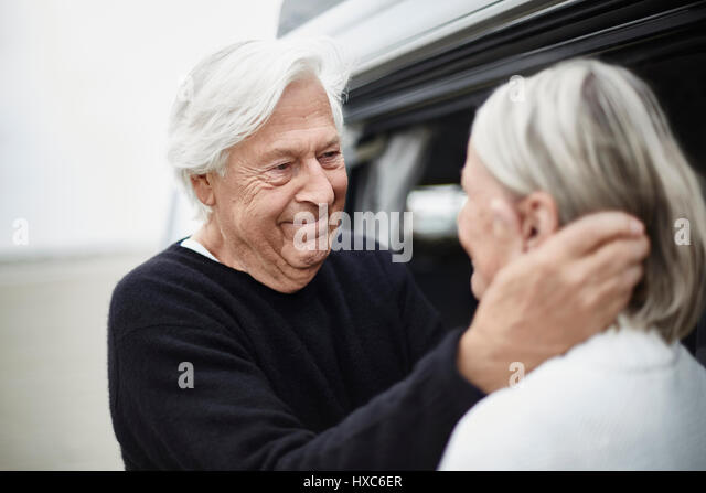Affectionate senior couple face to face - Stock Image