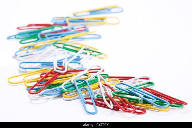 Group of colored paper clips. Isolated on a white background. - Stock Image