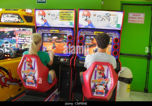 Lima Peru Miraflores Malecon de la Reserva Larcomar shopping center centre coin-operated game amusement arcade Mario - Stock Image