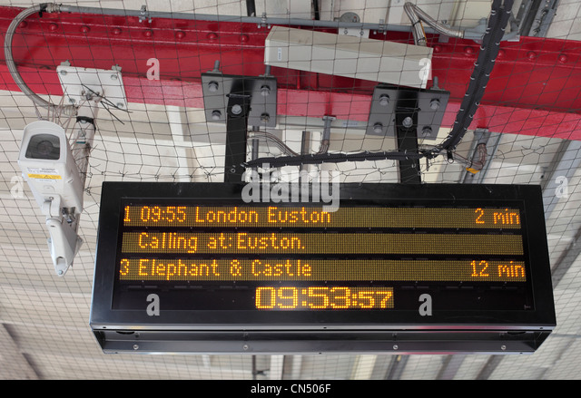 Destination and times of trains on London railway station platform electronic timetable - Stock Image