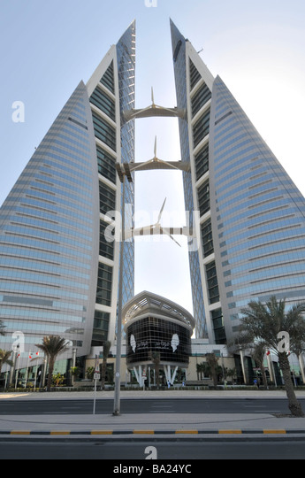 Bahrain Manama World Trade Center twin towers with wind turbines - Stock Image