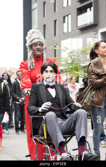 Participants walk around dressed as zombies and have zombie makeup at Montreal Zombie Walk 2014 edition - Stock Image