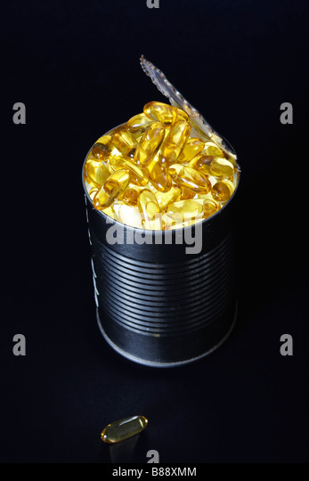 Fish Oil Capsules in a Tuna Fish Can - Stock-Bilder