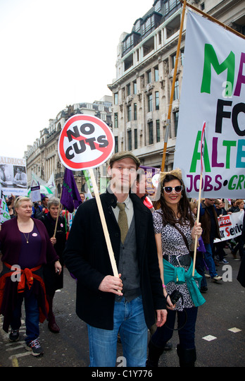 young couple with no cuts sign at March for the Alternative rally organised by the TUC, London, England - Stock Image