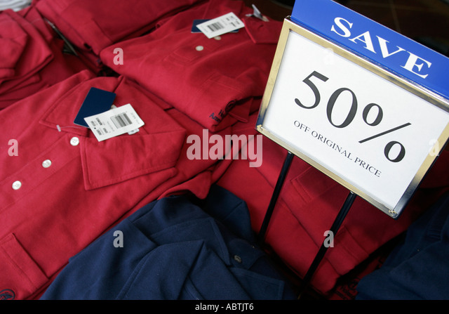 Puerto Rico Atlantic Ocean Holland America Line ms Noordam Shopping Arcade sign 50 per cent off clothing shirt - Stock Image