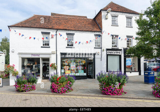 Row of traditional shops in The Holloway in Warwick - Stock Image