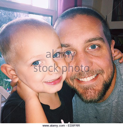 Portrait of father and son - Stock Image