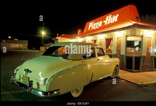 New Mexico vintage car night food car Pizza Hut Route 66 Tucumcari USA America United States - Stock Image