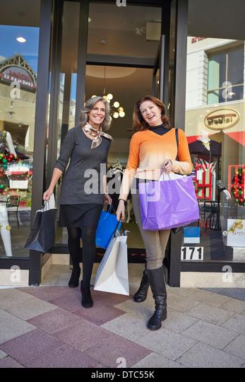 Women on shopping spree - Stock Image