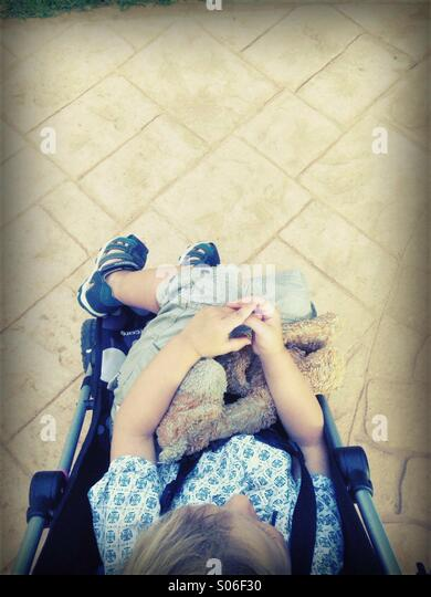 A parents view of child in a pushchair - Stock-Bilder