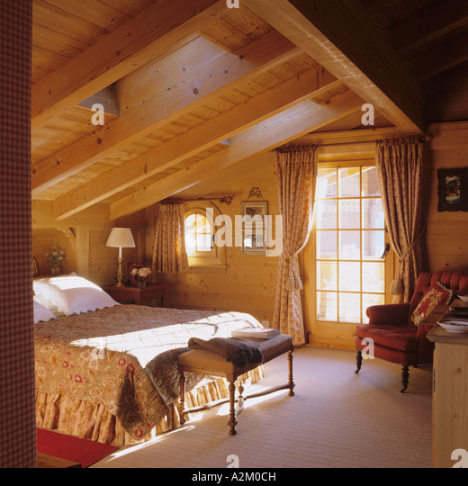 A bedroom with skylight window in a traditional chalet in Switzerland - Stock-Bilder