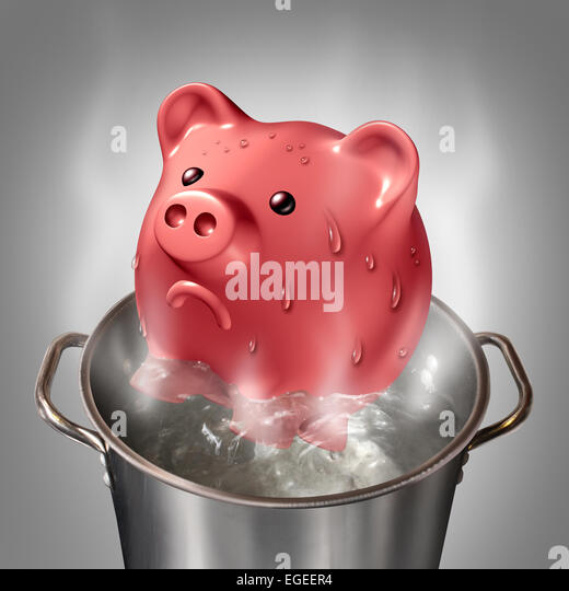 Financial heat business concept as a piggybank in a pot of hot boiling water as a symbol for money problems and - Stock-Bilder