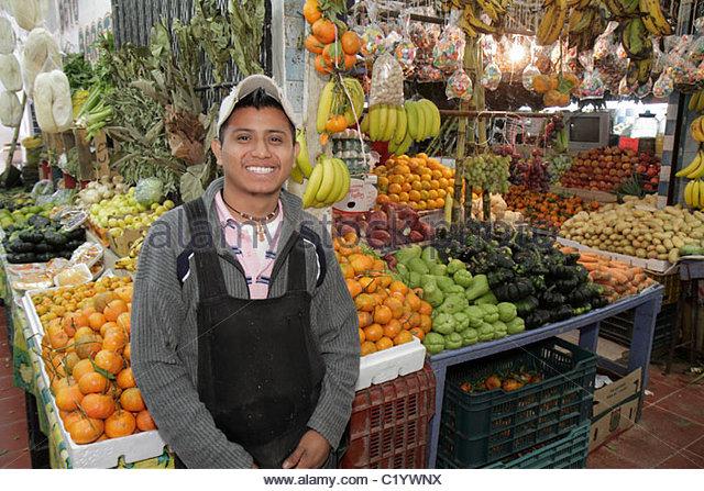 Cancun Mexico Yucatán Peninsula Quintana Roo Mercado 23 Hispanic man young adult smiling apron local produce - Stock Image
