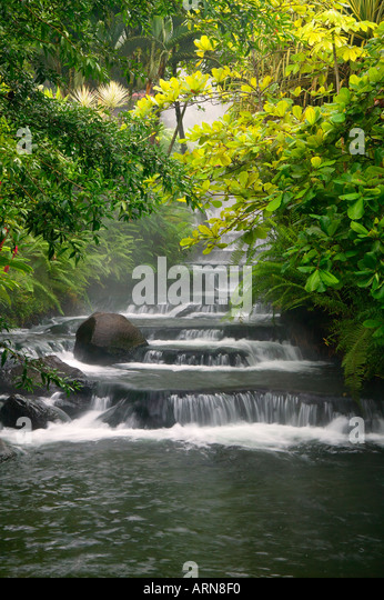 Stream flowing through Tabacon Hot Spring Resort and Spa Costa Rica - Stock Image