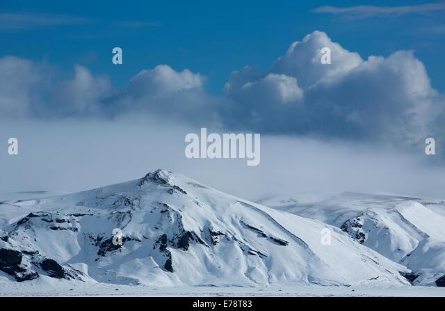 Harfursey in the snow, Myrdalssandur, southern Iceland - Stock Image