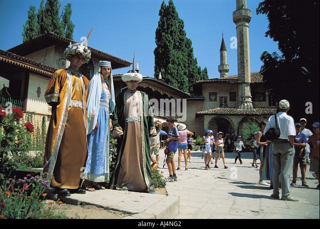 Tourists visiting Hansaray built in 1519, Crimea, Ukraine. - Stock Image