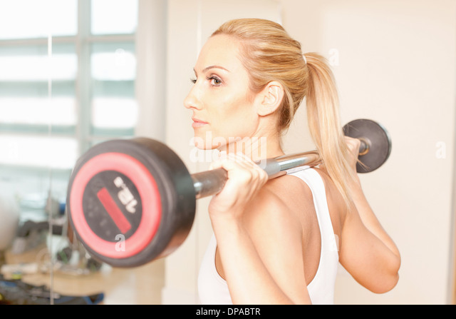 Woman weight-lifting - Stock Image