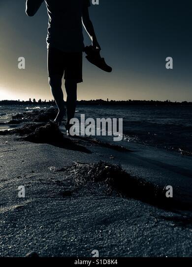 Walker on sandbar at sunset/ sunrise - Stock-Bilder