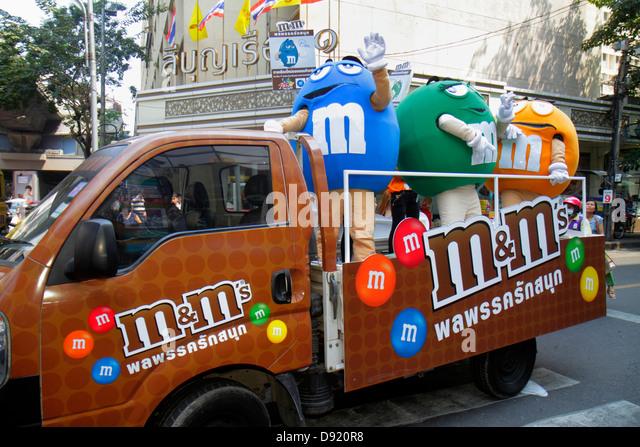 Bangkok Thailand Silom Silom Road promotion product m&m's candy vehicle advertising mascot character logo - Stock Image