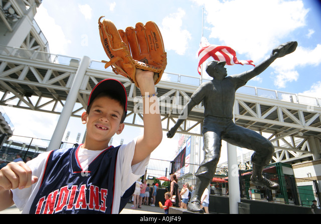 Cleveland Ohio Jacobs Field Cleveland Indians baseball Bob Feller statue young fan - Stock Image