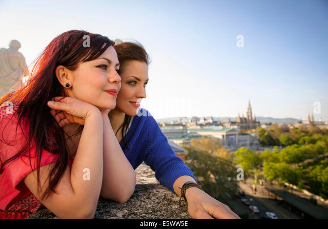 Two young adult women admiring the view, Vienna, Austria - Stock Image