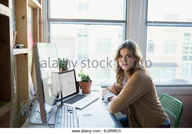 Portrait of confident businesswoman in office - Stock-Bilder