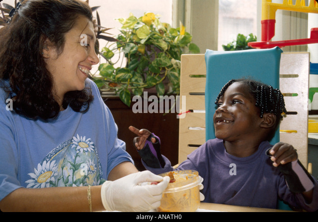 New Jersey East Orange Cerebral Palsy Center disabled student female therapist Black girl smile - Stock Image