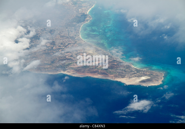 Aruba Netherlands Antilles Dutch Caribbean Sea Arashi Bay 30,000 foot aerial view from commercial airliner clouds - Stock Image