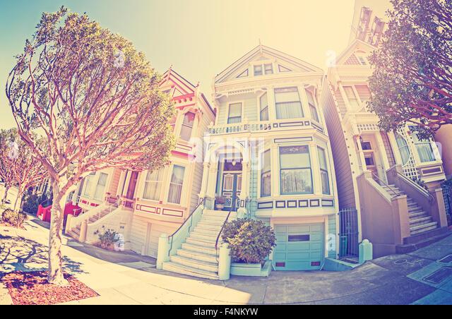 Vintage stylized fisheye lens street photo of the Painted Ladies, San Francisco, USA. - Stock Image