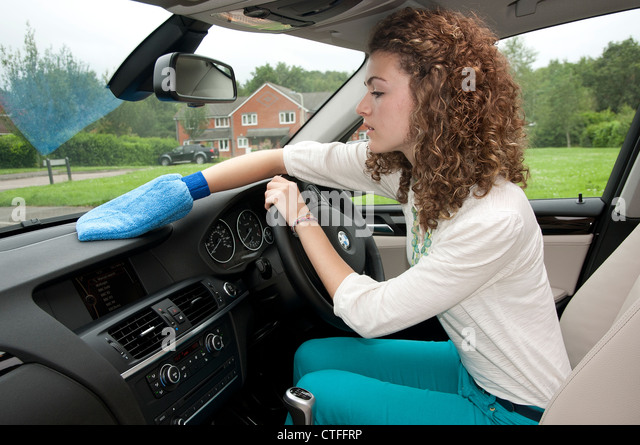 woman cleaning car interior stock photos woman cleaning car interior stock images alamy. Black Bedroom Furniture Sets. Home Design Ideas