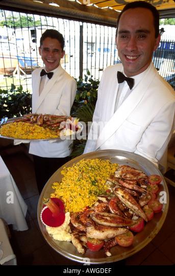 Brazil South America Rio De Janeiro Sol E Mar Restaurant food waiters - Stock Image