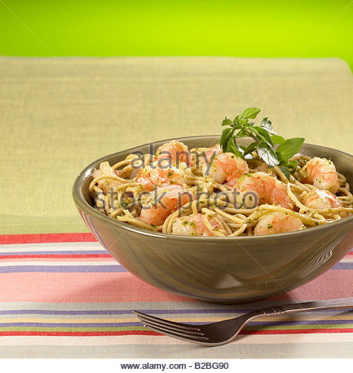 close up of shrimp and pasta entree - Stock Image