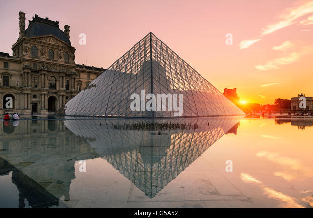 Paris, Louvre pyramid at sunset - Stock Image