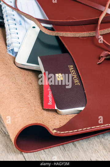 passport in the leather bag,selected focus. - Stock Image