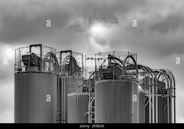 Black and white image of Industrial architecture at a china clay drying plant at Par beach, Cornwall. - Stock Image