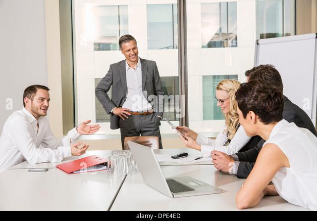Businesspeople meeting in conference room - Stock-Bilder