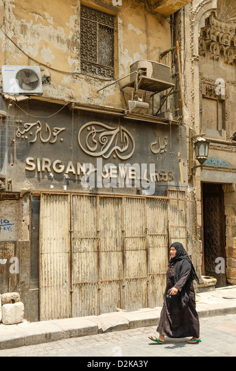 veiled woman cairo old town in egypt - Stock Image