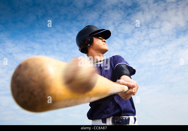 baseball player hitting - Stock Image