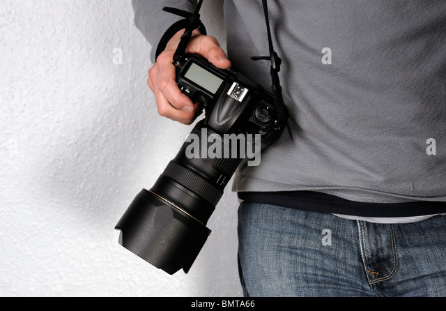 Man holding a camera - Stock Image