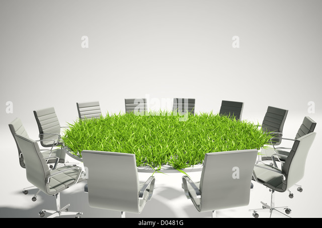 Conference table covered with grass - business outlook concept - Stock Image