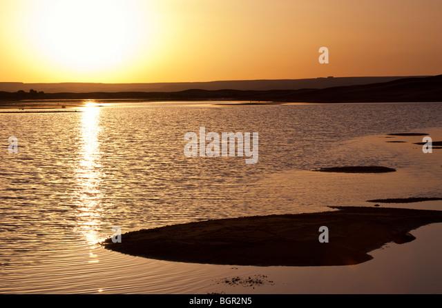 sunrise at desert lake - Stock Image